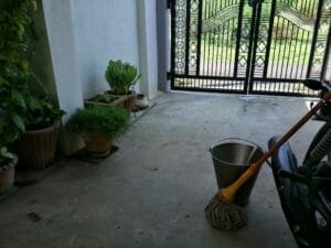 Washing or cleaning front yard or black backyard
